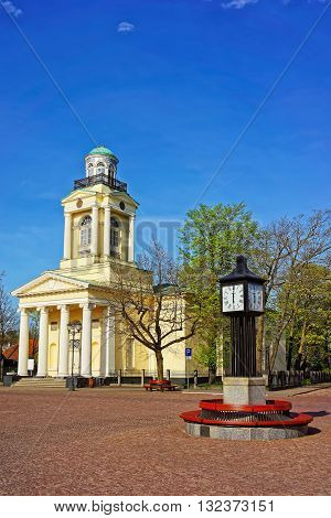 Clock And Lutheran Saint Nicholas Church In Ventspils