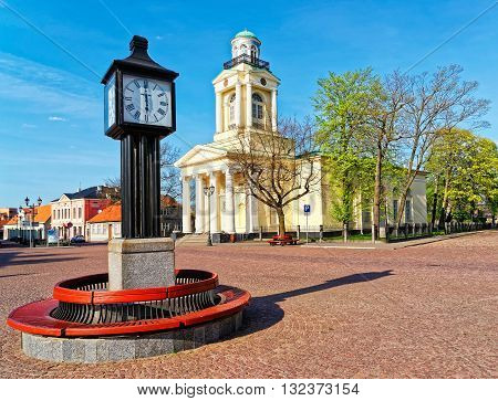 Clock And Lutheran Church Of St Nicholas In Ventspils
