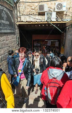 Jerusalem, Israel - February 15, 2013: Tourists Walking Along Narrow Streets