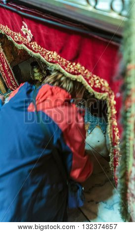 Bethlehem, Israel - February 19, 2013: Pilgrims Praying Near Silver Star