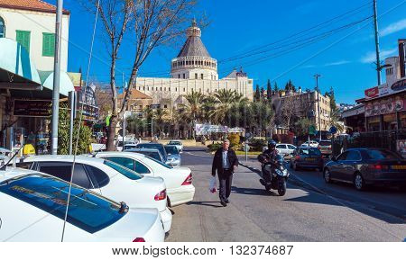 Nazareth, Israel - February 21, 2013: Tourist Walking Near Annunciation Cathedral