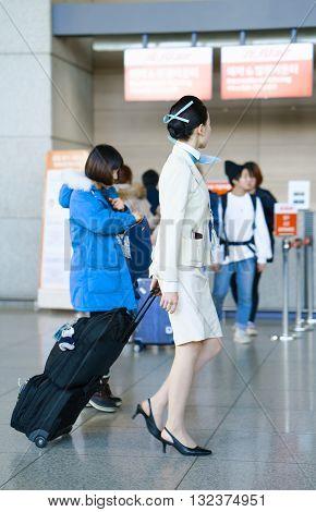 Asian Air Flight Attendant At Incheon International Airport