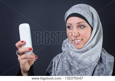 Muslim Woman In Hijab Making A Selfie