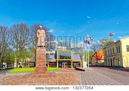Ventspils Library And Janis Fabriciuss Monument In Ventspils In Latvia