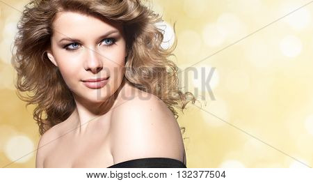 Woman with blond hair thick clean perfect skin and brown eyebrows. On white background