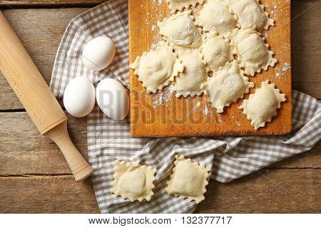 Uncooked ravioli on cutting board
