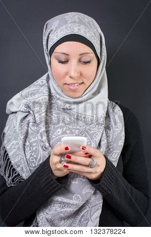 Muslim Woman In Hijab Holding A Mobile Phone