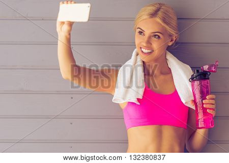 Beautiful Sports Girl With Gadget