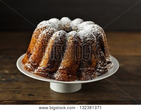 homemade bundt cake with icing sugar on top.