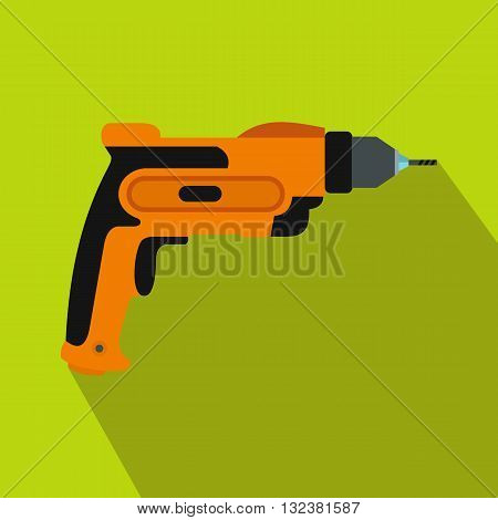 Orange hand drill icon in flat style on a green background