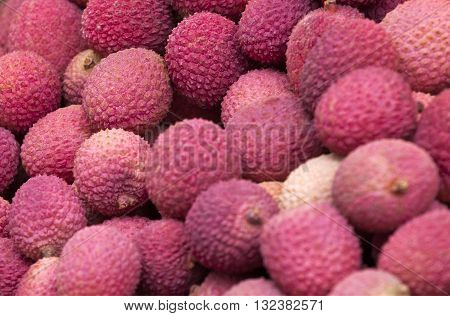 Group of fresh lychee. Organic products on a market