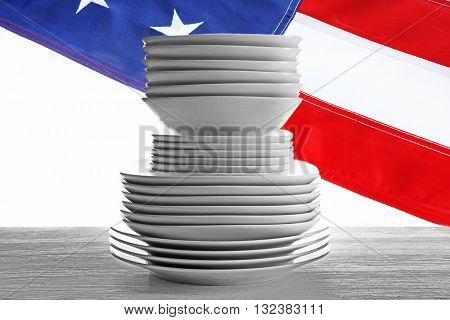 Stack of different ceramic plates on wooden table. American cuisine food concept