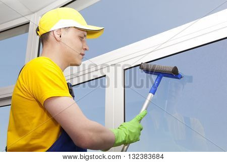 Professional cleaning, man washes window