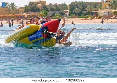 banana boat floating on the water. happy people having fun on banana boat