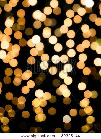 Bokeh abstract background in the gold color