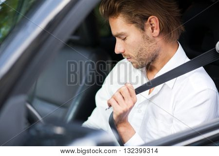 Man fastening his safety belt