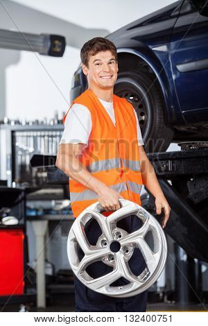 Smiling Mechanic Holding Alloy