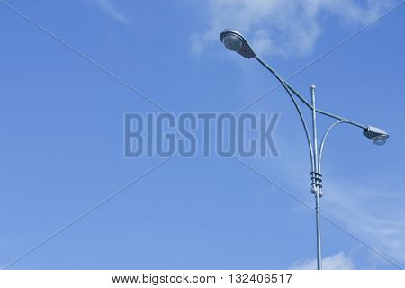 Street lamp and blue sky, background, electricity