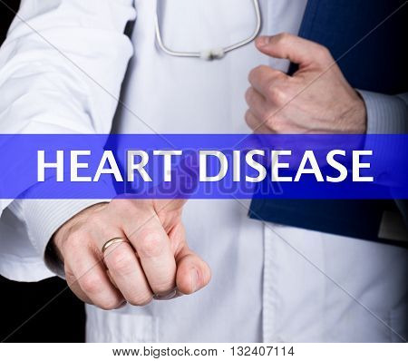 technology, internet and networking in medicine concept - medical doctor presses heart disease button on virtual screens. Internet technologies in medicine.