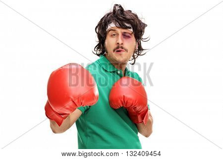 Young boxer with a black eye and red boxing gloves isolated on white background