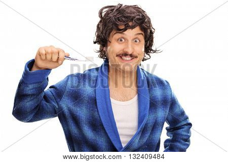 Young joyful man in a blue bathrobe holding a toothbrush isolated on white background