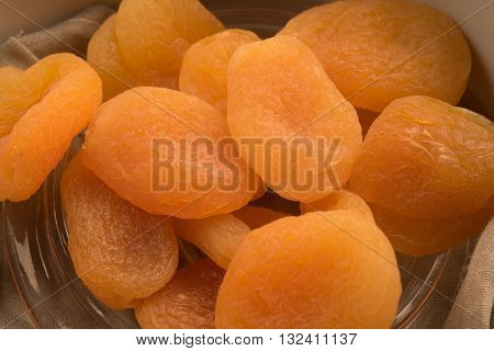 dried apricot in a glass bowl close up view