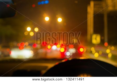 Blur Image Of Inside Cars With Bokeh Lights With Traffic Jam On Night Time