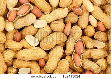 large number of shelled and unshelled peanuts