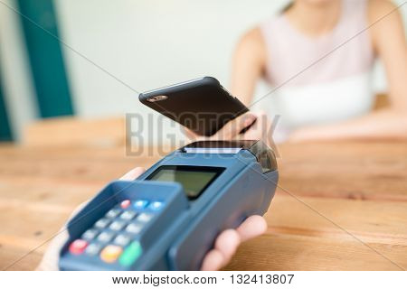 Woman checkout by mobile phone