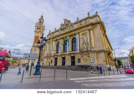 Lille, France - June 3, 2015: Main opera building, beautiful stone building with really nice statues and decorations along facade top.
