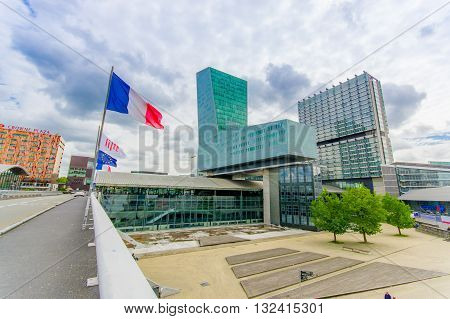 Lille, France - June 3, 2015: Modern architecture railroad station Lille Europe with its easyily recognizable shape, french flag hanging.