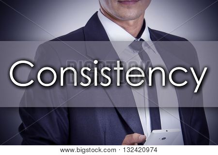 Consistency - Young Businessman With Text - Business Concept