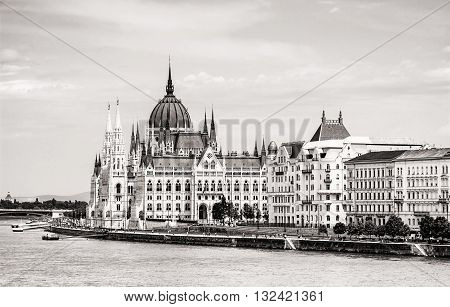 Hungarian parliament building - Orszaghaz also known as the Parliament of Budapest Hungary. Danube river. House of the nation. Black and white photo. Travel destination. Architectural theme.