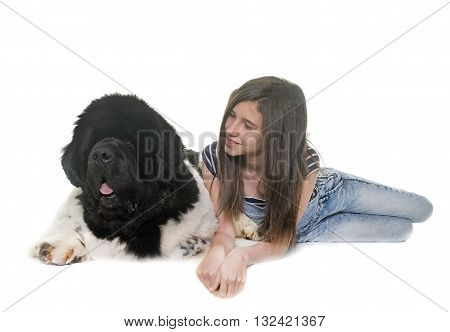 teenager and newfoundland dog in front of white background