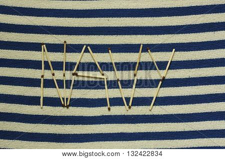 match word navy on blue white textile close up