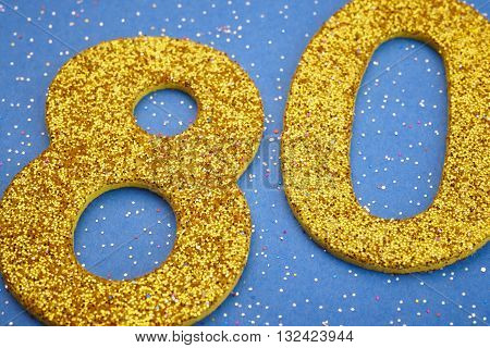 Number eighty yellow color over a blue background. Anniversary. Horizontal