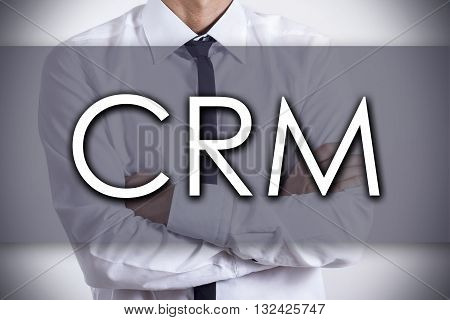 Crm - Young Businessman With Text - Business Concept