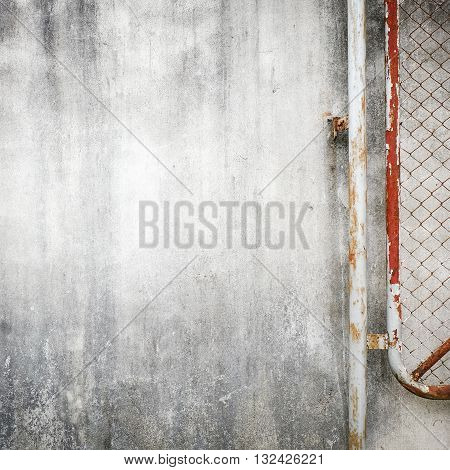 Cement Wall Background With Rusty Iron Chain Wire Fence