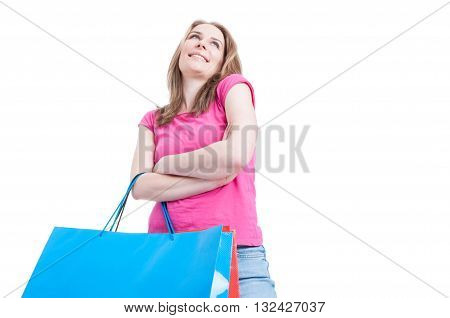 Low Angle Of Happy Shopaholic With Shopping Paper Bags