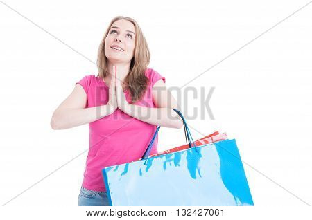 Happy Shopaholic With Colorful Shopping Bags Praying