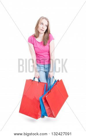Full Body Of Young Girl With Shopping Bags Looking Bored