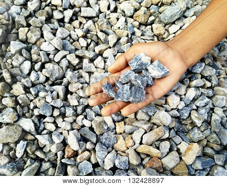 Gravel rock on hand this image focus on rock on hand