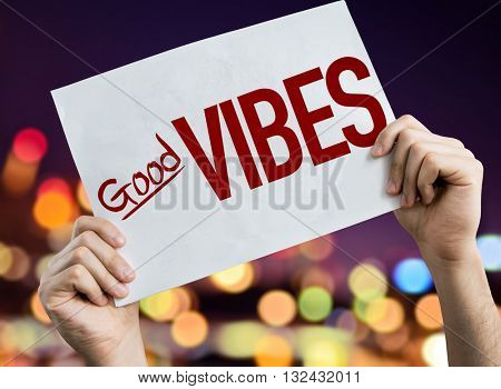 Good Vibes placard with night lights on background