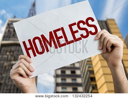 Homeless placard with cityscape background