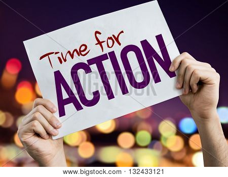 Time for Action placard with night lights on background