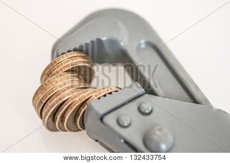 Wrench and coins . The concept of financial reliability .