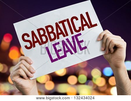 Sabbatical Leave placard with night lights on background