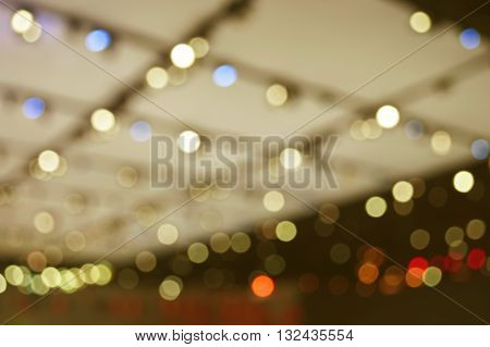 Defocused light and shadow of shopping mall warm tone abstract background