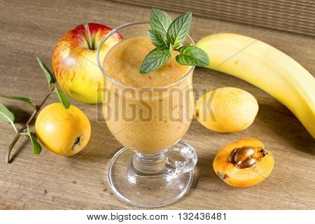 Diet smoothies from loquats, bananas and apples. Vintage style