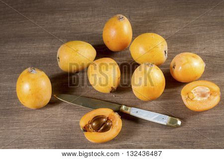 loquats on wooden background. Vintage style